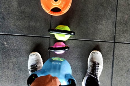 Person lifting kettlebells