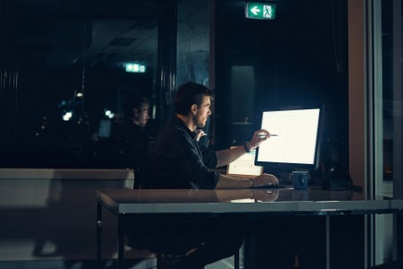 Shot of a businessman working late in an office