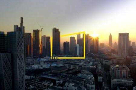 Sunrays over city skyscrapers