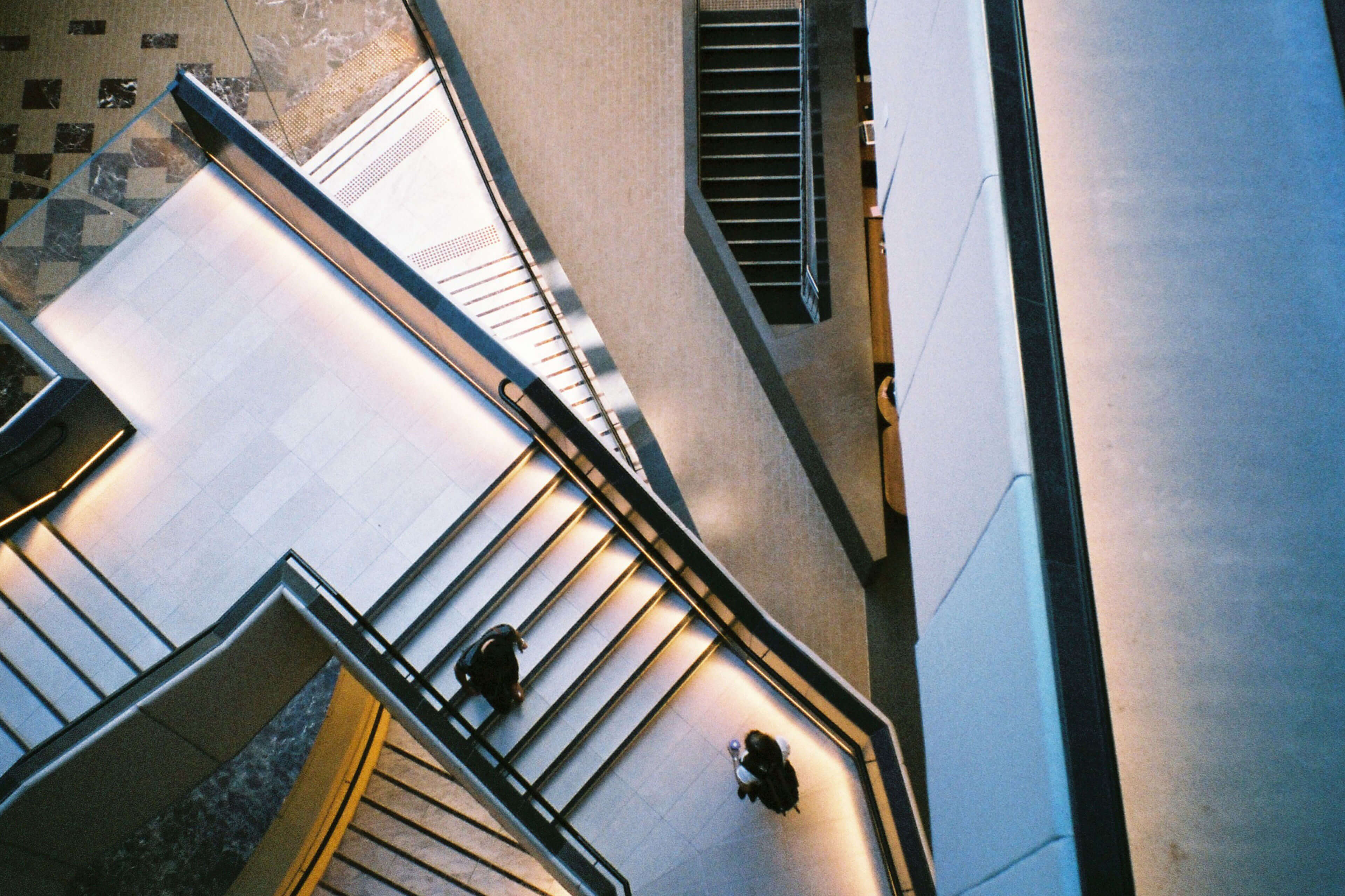 Abstract staircase with passersby