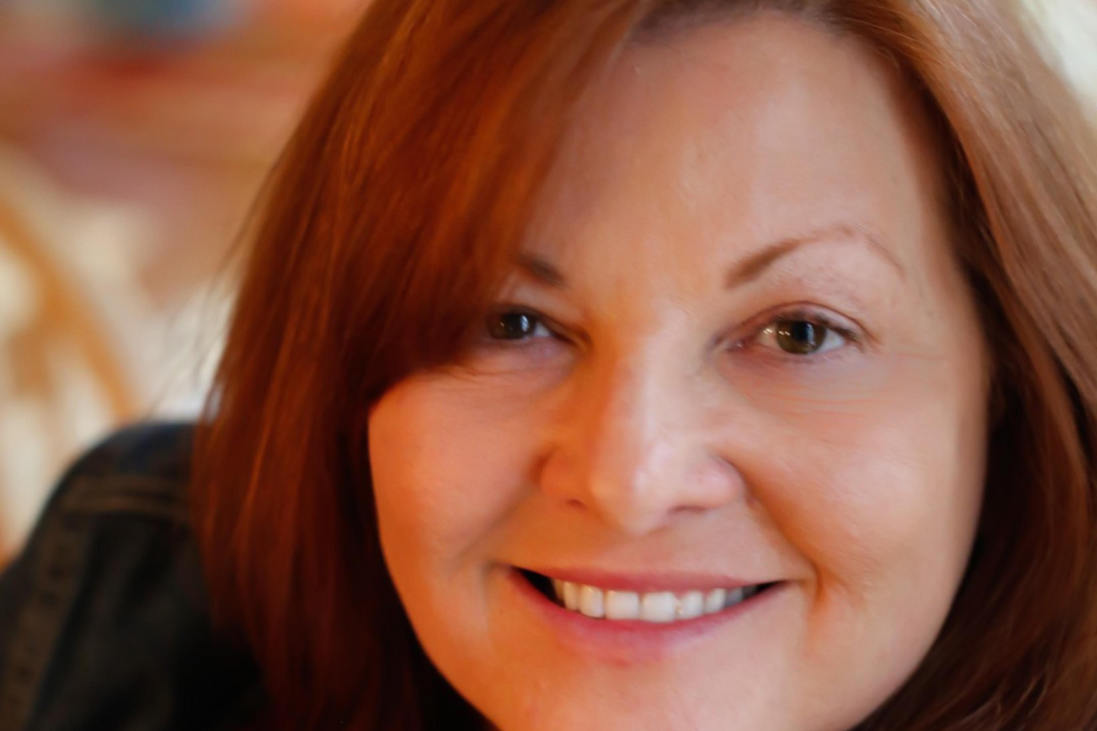 A photographic portrait of Debbie Carter