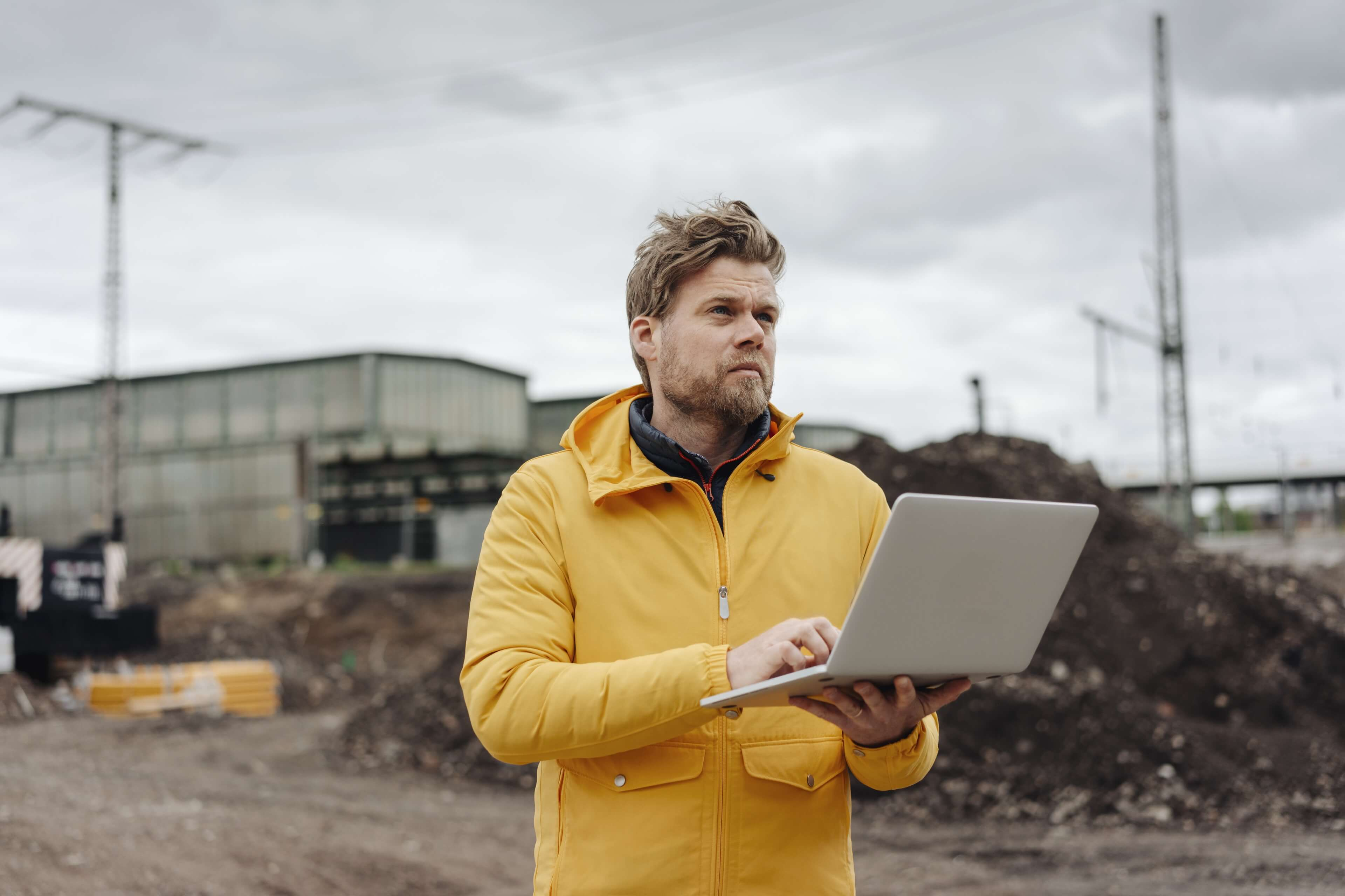 A man on site using his laptop