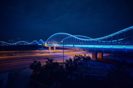 blue bridge at night in dubai