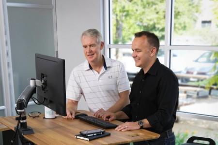 VARIDESK leaders standing working product