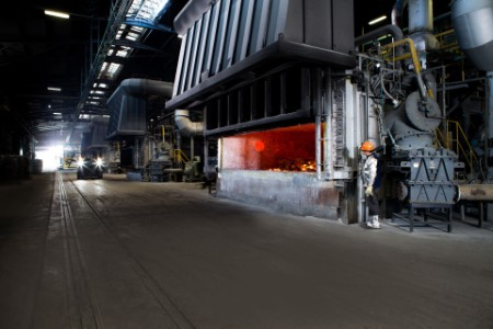 Worker checks furnace in foundry