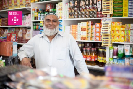 Hello Paisa shopkeeper smiling