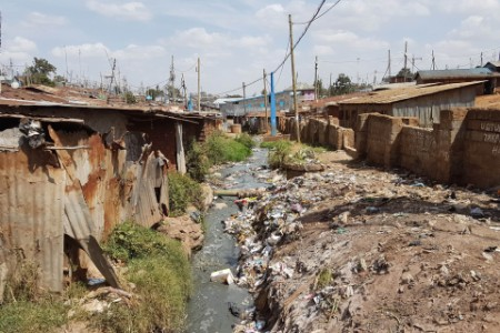 shanty town polluted stream