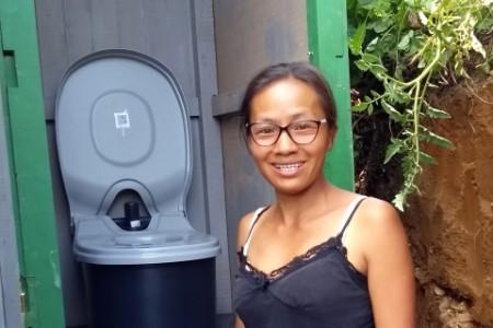 Woman posing in front of loowatt unit