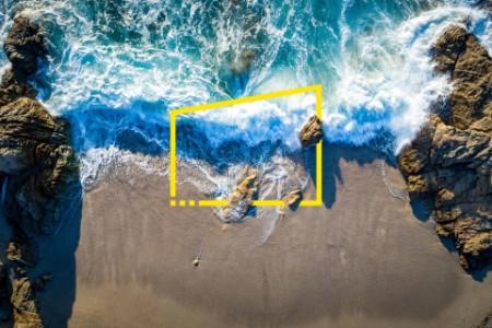 Aerial view of waves crashing on beach, Calvi, Corsica, France