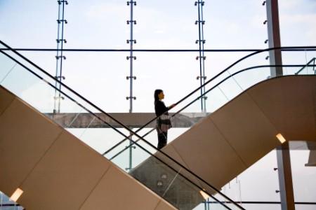 business-women-going-up-escalator