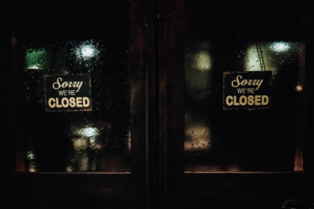 Closed signs on wet glass
