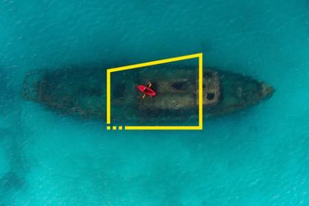 Red kayak floating above a shipwreck carlisle bay Barbados