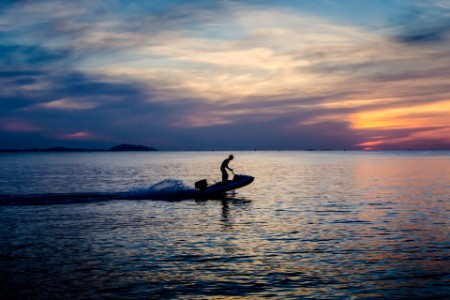 Silhouette of a sportsman with jet ski at sea