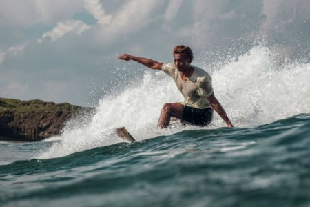 Man catching a wave on surfboard