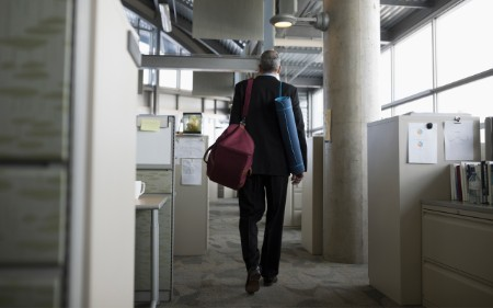 Business man leaving the office after being fired