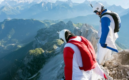 Experimenting with risk. Wingsuit jumpers assess a flight.