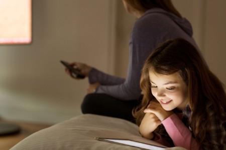 girl illuminated touchscreen