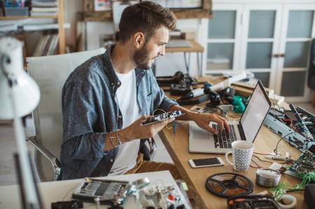man building computer