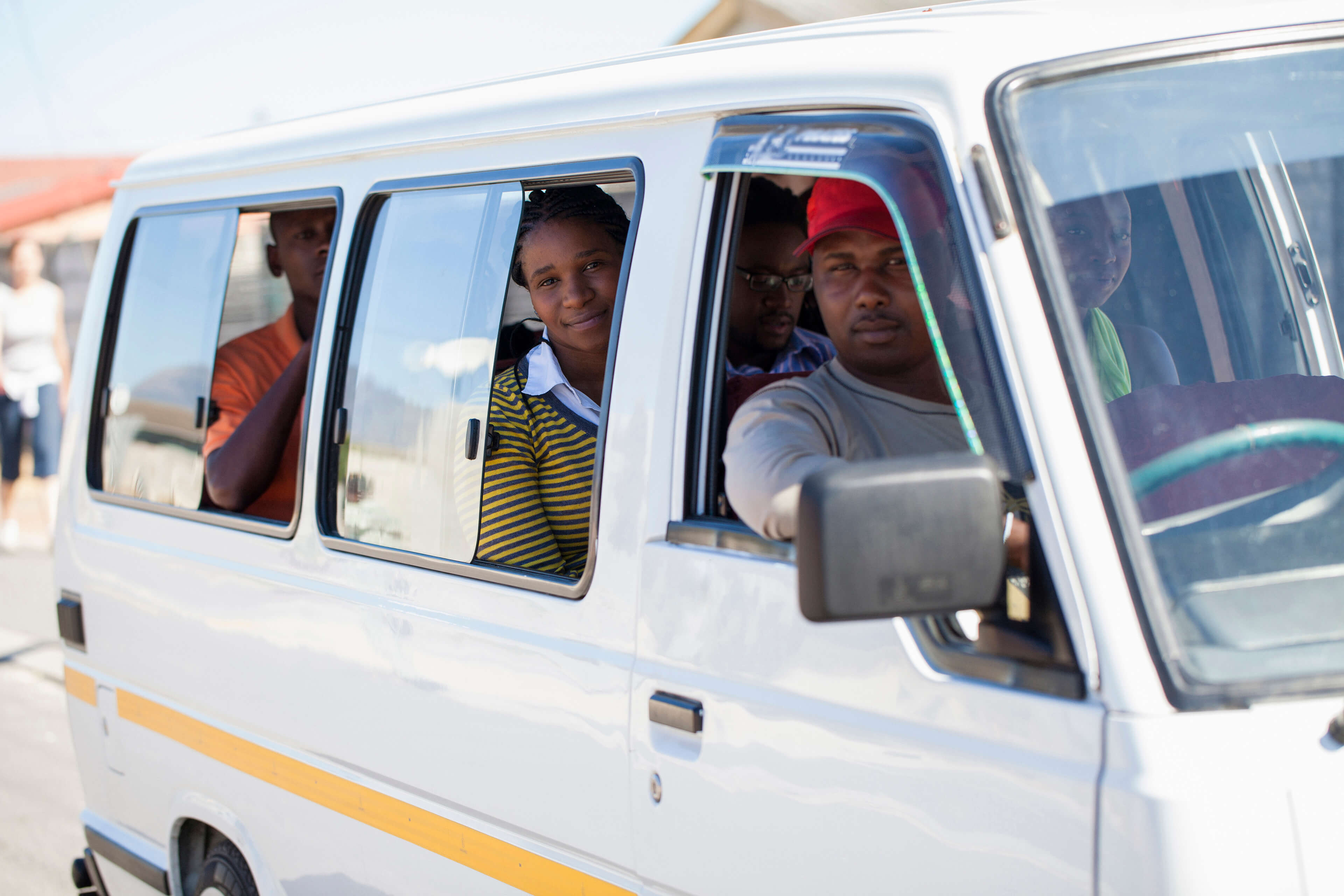 People getting a shared ride in a white van