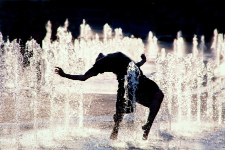 person leans backward bend fountain