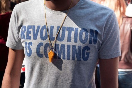 person t shirt says revolution coming