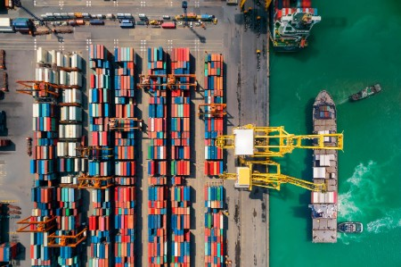 Aerial shot of shipping port with cargo containers