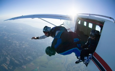 Skydivers jumping out of an airplane