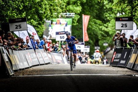 Velon cyclist finish line cross crowd hammer series