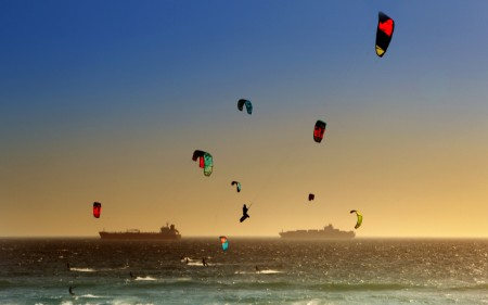 Windsurfers at sunset