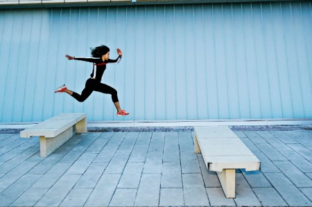 woman leaping benches