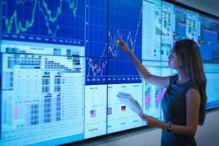 woman managing data large interactive screen