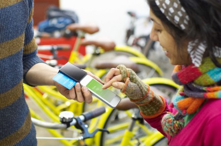 woman paying bicycle phone
