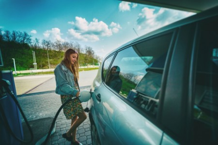 woman refilling car gas pump