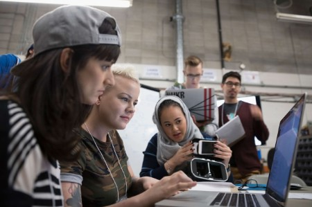 women engineers working laptop together