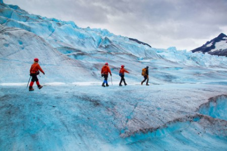 Four people walking on mendenhall glacier Alaska USA