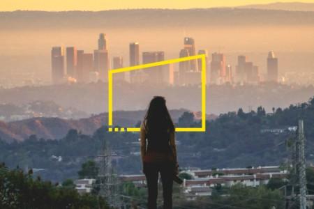 Woman camera hill city sunset