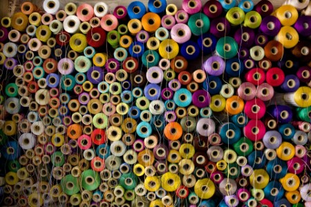 ey-colorful-stack-of-cotton-thread-reels