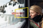 Woman looking through window train Switzerland background