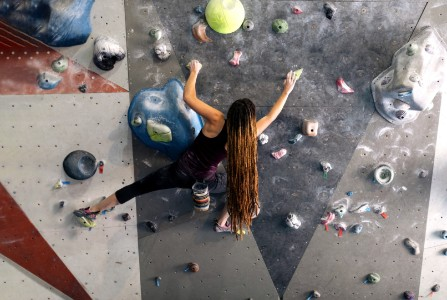 Lady with long hair on rock climbing wall