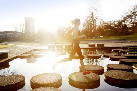woman running park stepping stones