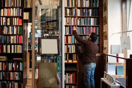 Man searching book antique library