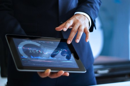 man showing graph on tablet