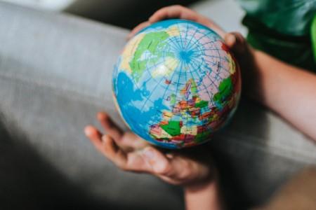 globe map europe hand close up