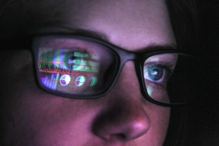 woman watching screen with glasses