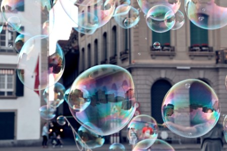 bubbles with buildings in background