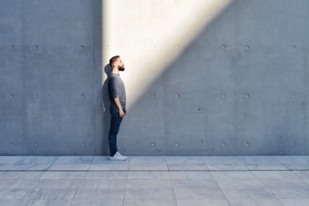 man standing looking to future with beam of light