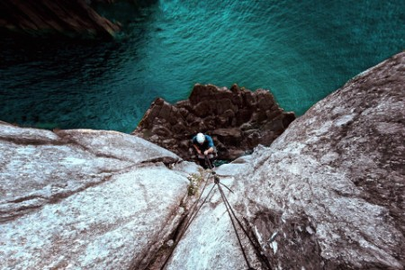 Photographic portrait of man rock climbing