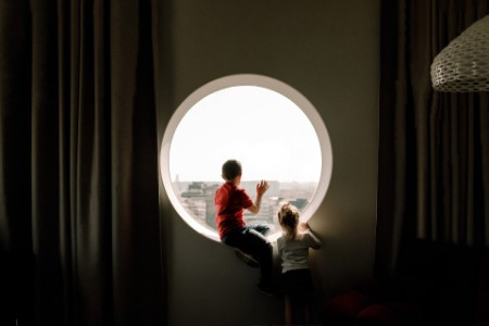 kids looking outside through a window