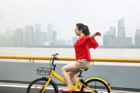 woman cycling yellow bike
