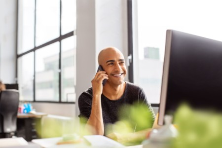 Mature man talking on phone and smiling
